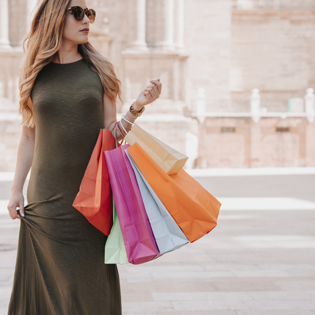 Young woman shopping photographs colors