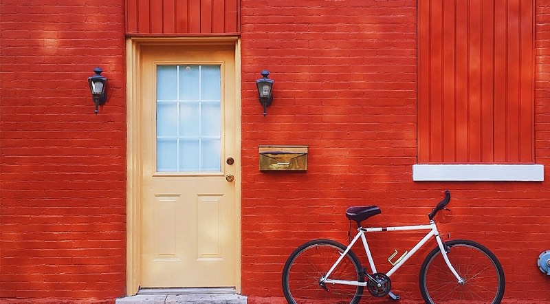 Bike on Red Wall