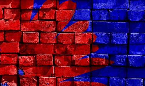 Red and blue colored brick wall