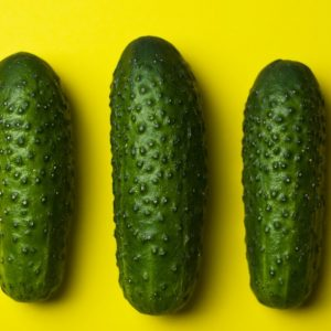 Cucumbers on yellow background
