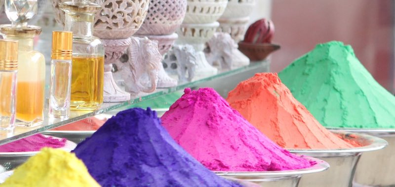 Color powder mounds on display