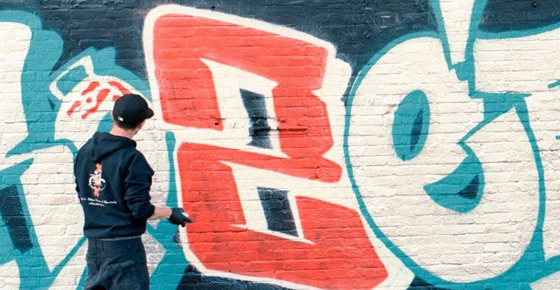 Man drawing graffiti on the wall