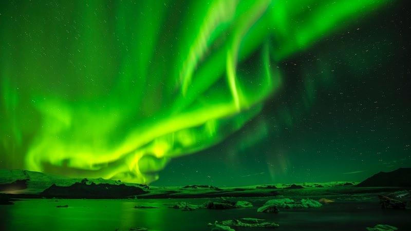 Curtain of green aurora borealis lights