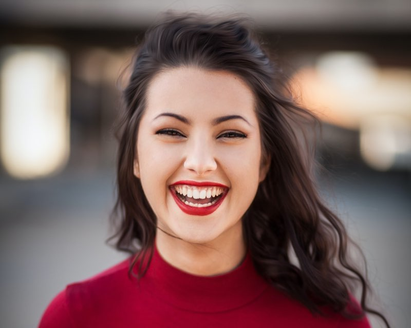 Woman laughing in front of camera
