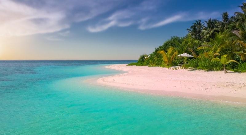Photograph of an island on a blue ocean