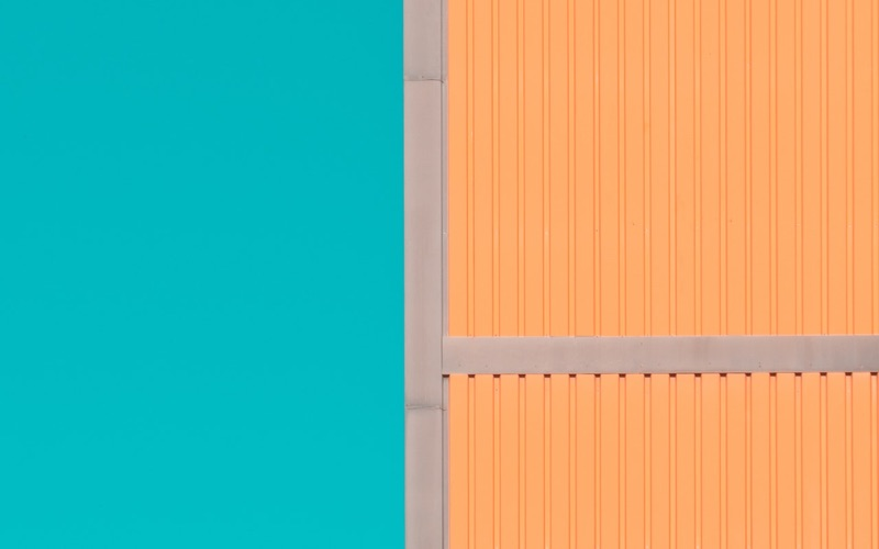 Orange building against a turquoise sky