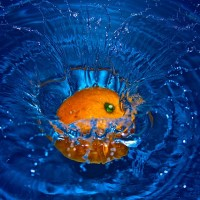 Orange Falling in Water