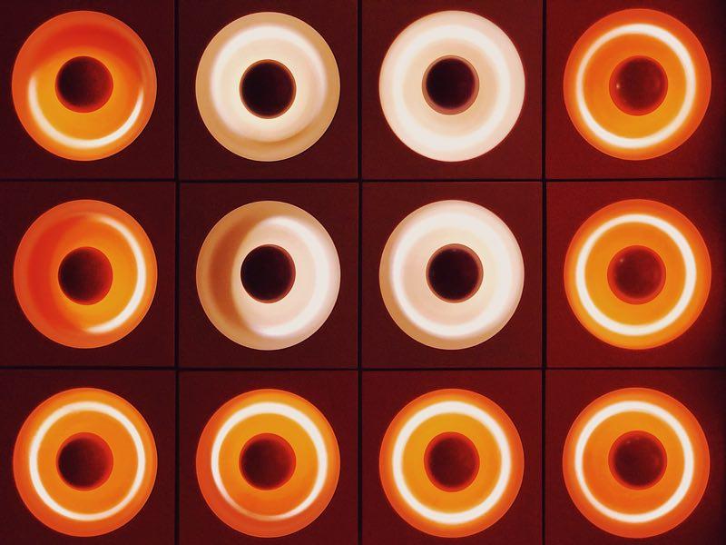 Circular orange neon lights on the ceiling