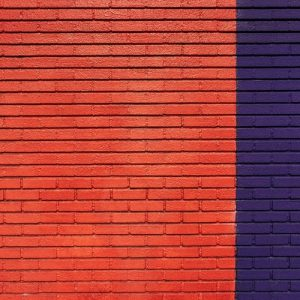 Orange and purple wall of bricks