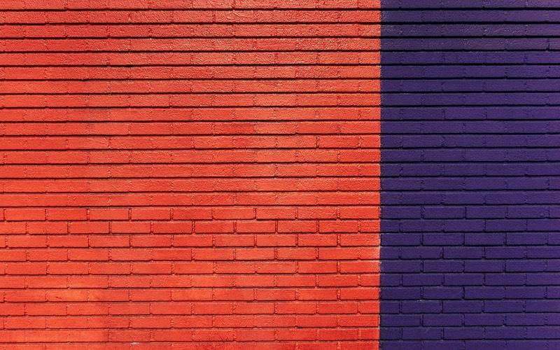 Orange and purple wall of bricks