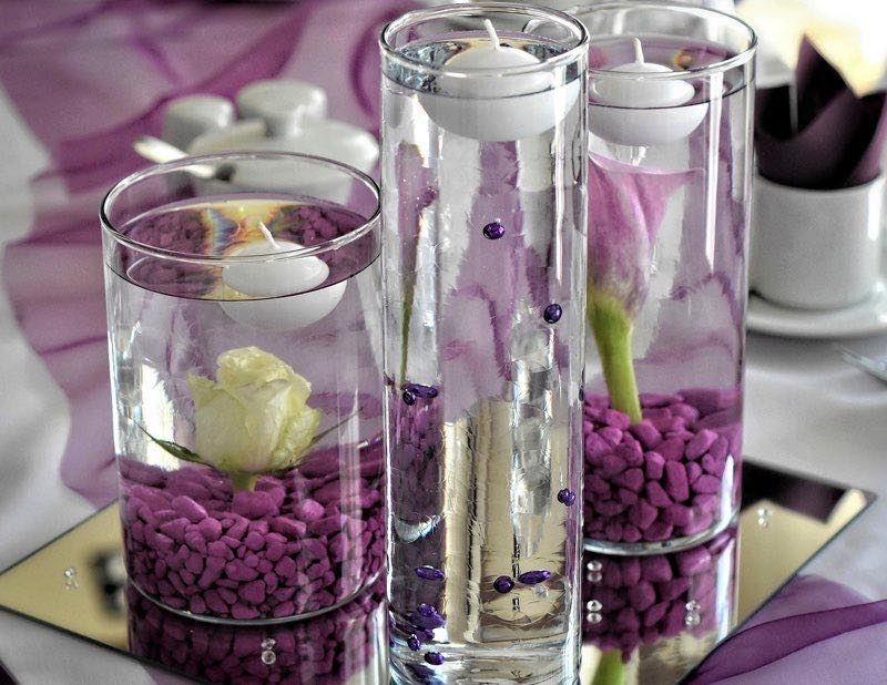 Decoration with purple/violet stones and white candles