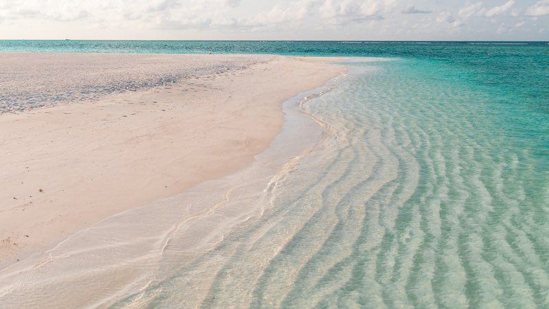 Sandy beach and blue-green waters