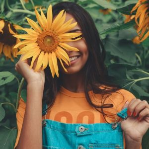 Girl with sunflower plants