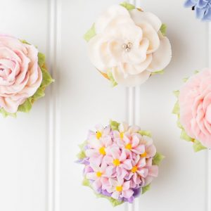 Small beautifully decorated tasty cupcakes