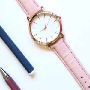 Watch with pens and pencils