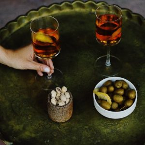 Wine served with olives and pistachio nuts