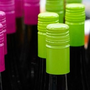 Colorful cap covers of wine bottles